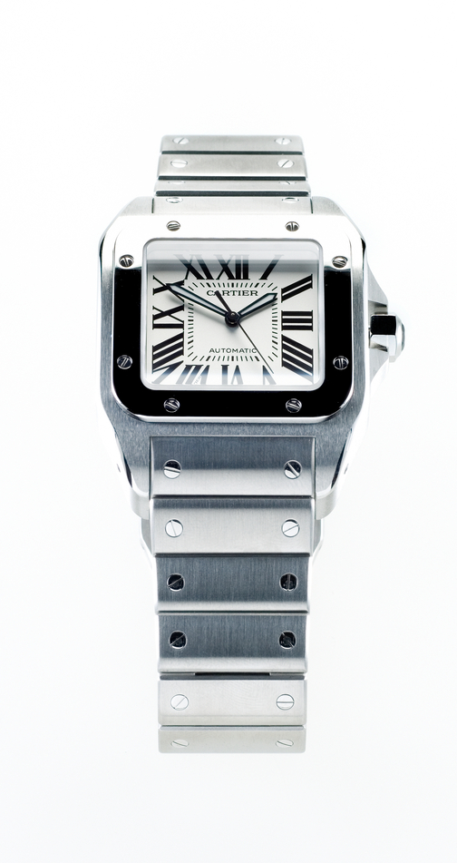 Leiden, The Netherlands - October 11, 2007: Product shot of a Cartier Santos Steel Automatic wristwatch on white background. This watch has a polished stainless steel case, a steel strap and an automatic movement.