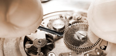 antique pocket watch being repaired ,sepia toned